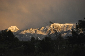 Snow on the mountains; view from our Ruby Bay house