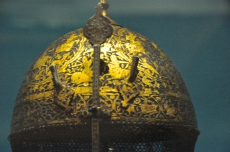 Detail of helmet, chiselled and gilded with hunting scenes