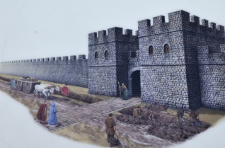 Artist depiction of Hadrian's Wall with gate and towers