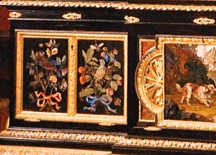 Detail of ebony cabinet, pictures made of inlaid stone