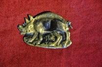 Richard III's symbol, a white boar, in brass