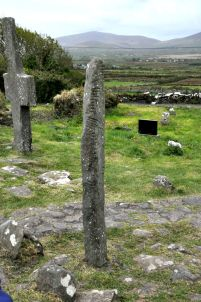 Large stone cross (background) and ogham stone