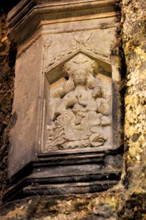Virgin and child, under the arch of the tower