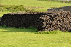 Stacked peat logs in Doolin