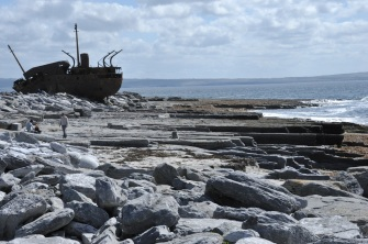 The shipwrecked An Plassy resting high on the rocky shore