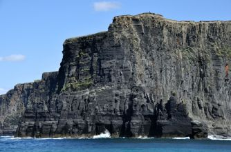 The rock wall of one of the cliffs