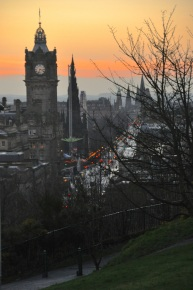 Princess Street, with a glimpse of the Sir Walter Scott Memorial and Princes Street Gardens fair