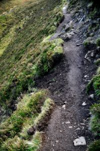 Narrow trail with crumbled edge