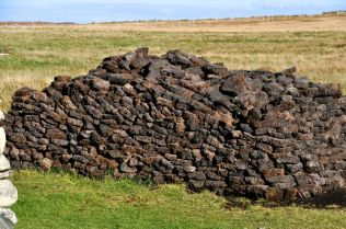 A mound of peat logs