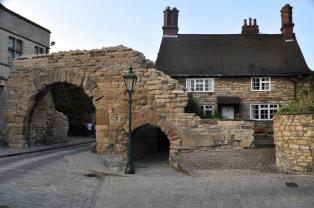 Newport Arch, 3rd century Roman gate; much of it is below ground level