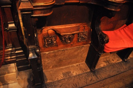 Misericords, one in the down position, and one up showing the misericord