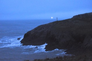 Lighthouse shining in the distance
