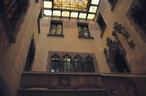 The upper landing, with ornate windows and doors - and stained glass ceiling
