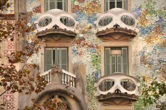 Colorful tile decoration of the wall, with carnival-mask-like balconies