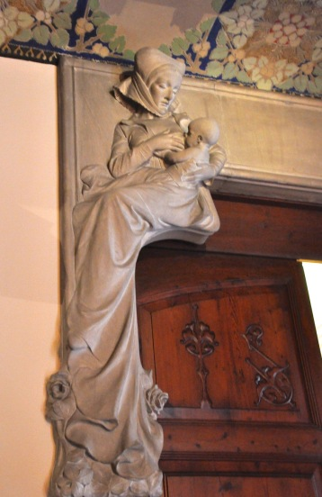 A wet nurse, stone relief in the entrance hall