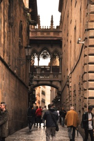Further down the street, the Carrer del Bisbe bridge