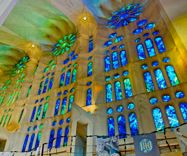 Blue and blue/green stained glass windows at the end of the nave; picture from the internet