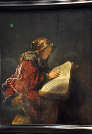 An Old Woman Reading, Probably the Prophetess Hannah, by Rembrandt Harmensz van Rijn, 1931